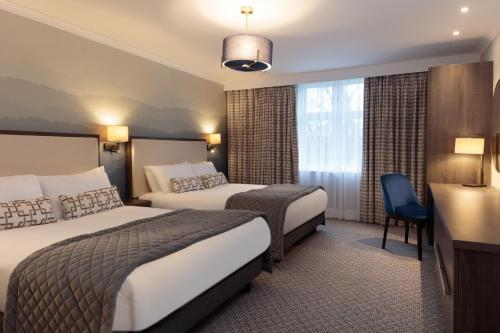 A bed or beds in a room at Mercure Blackburn Dunkenhalgh Hotel & Spa