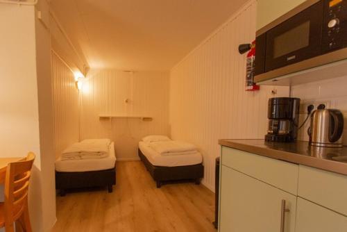 Ein Bett oder Betten in einem Zimmer der Unterkunft Folkshegeskoalle Schylgeralân
