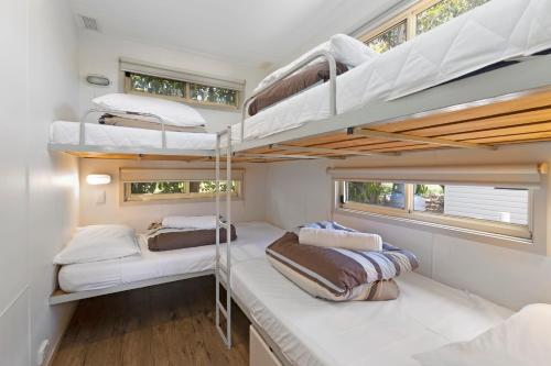 A bunk bed or bunk beds in a room at BIG4 Apollo Bay Pisces Holiday Park
