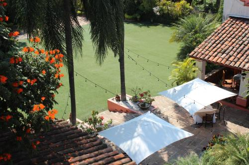 A view of the pool at Hotel Boutique Casa de Campo or nearby