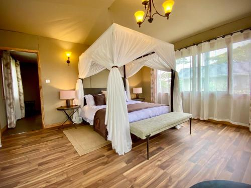 A bed or beds in a room at Lions Paw Ngorongoro