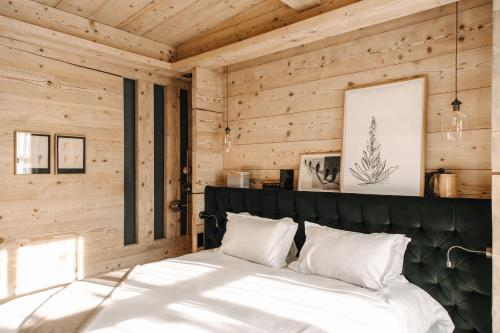 A bed or beds in a room at Alpaga