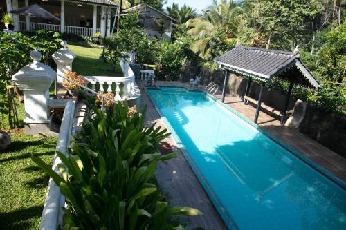 A view of the pool at Manor House-Kandy or nearby