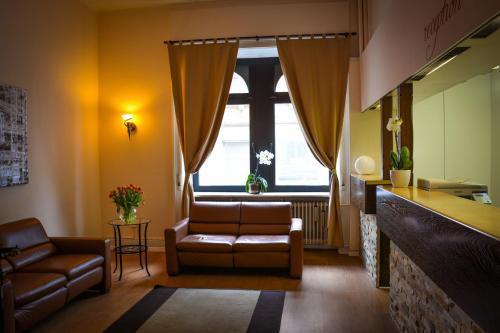 Гостиная зона в Hotel am Landeshaus