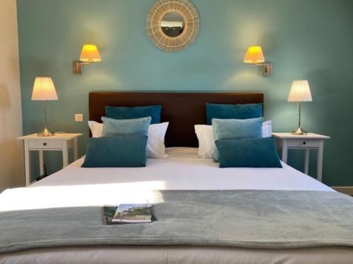 Un ou plusieurs lits dans un hébergement de l'établissement Hôtel Les Vieilles Tours Rocamadour