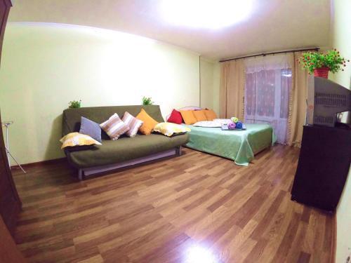 A bed or beds in a room at Апартаменты на Воронежской, 34к3