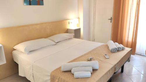 Letto o letti in una camera di Hotel Paris