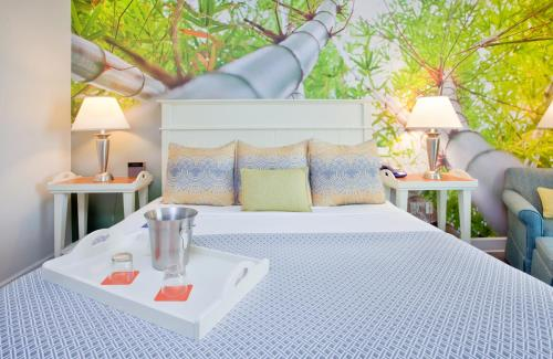 A bed or beds in a room at Hotel Indigo - Sarasota