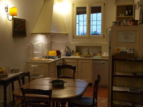 A kitchen or kitchenette at Le Stanze di Torcicoda