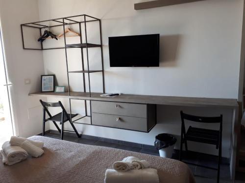 TV o dispositivi per l'intrattenimento presso Agua Green Resort