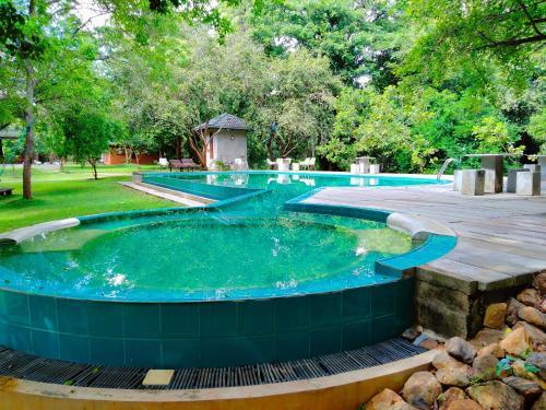The swimming pool at or near Nil Diya Mankada Safari Lodge