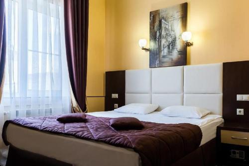Кровать или кровати в номере Lite Hotel Волгоград