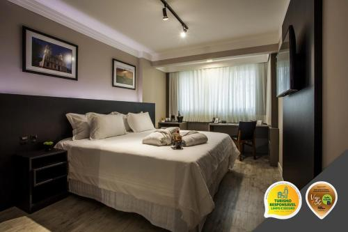 A bed or beds in a room at Santa Inn Hotel