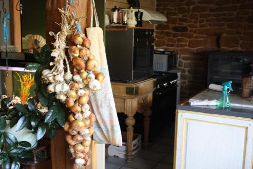 Cuisine ou kitchenette dans l'établissement Au bois de mon coeur