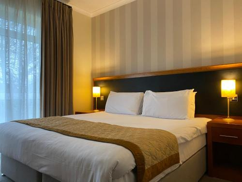 A bed or beds in a room at Brook Mollington Banastre Hotel & Spa