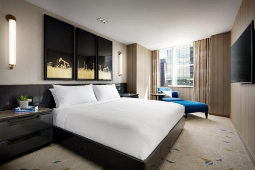 A bed or beds in a room at JW Marriott Edmonton ICE District