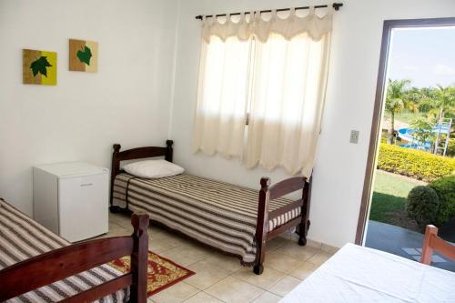 Cama ou camas em um quarto em Hotel Fazenda Monte Sião