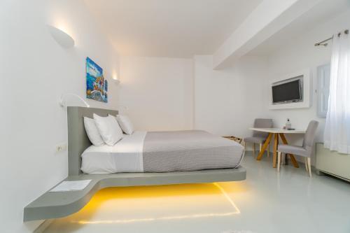 Un ou plusieurs lits dans un hébergement de l'établissement Central Fira Hotel