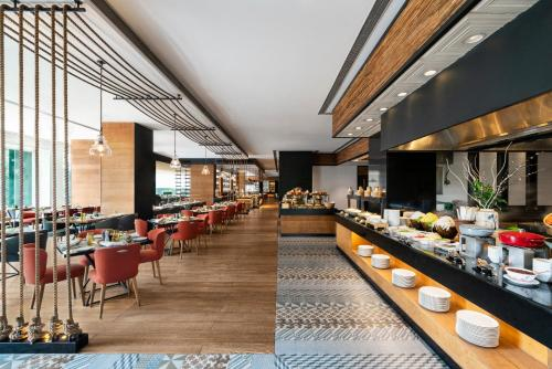 A restaurant or other place to eat at Shangri-La's - Eros Hotel, New Delhi