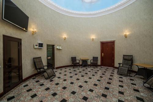 Лобби или стойка регистрации в Отель Артис Плаза