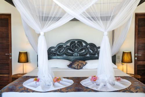 A bed or beds in a room at Next Paradise Boutique Resort