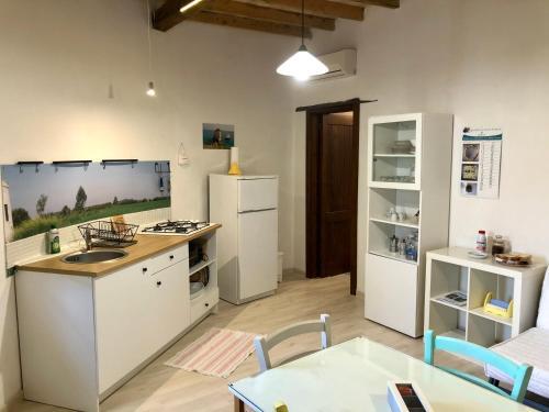A kitchen or kitchenette at Masseria La Torre