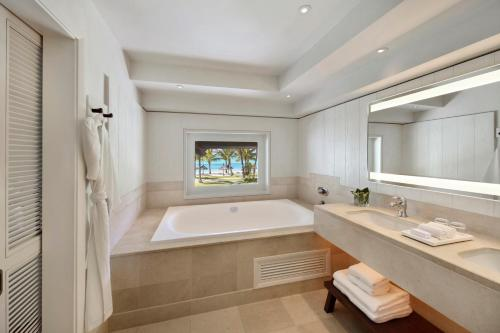 A bathroom at LUX* Le Morne Resort