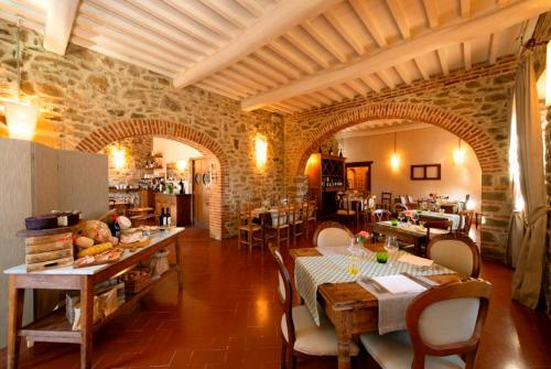 A restaurant or other place to eat at Castello Di Gargonza