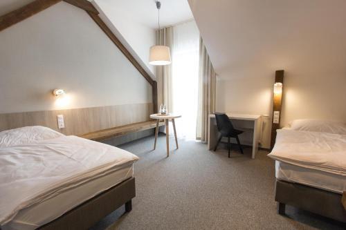 Łóżko lub łóżka w pokoju w obiekcie Hotel Górecznik