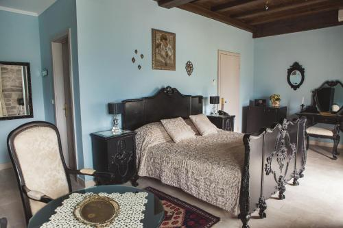 A bed or beds in a room at Palazzo Radomiri Heritage Boutique Hotel