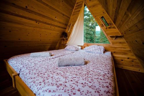 Postelja oz. postelje v sobi nastanitve Glamping Ob Robu Gozda