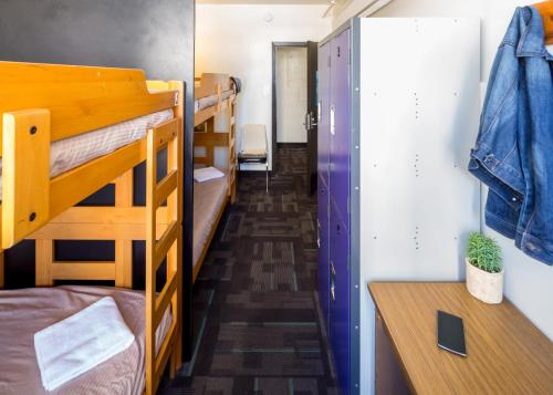 A bunk bed or bunk beds in a room at HI Vancouver Downtown