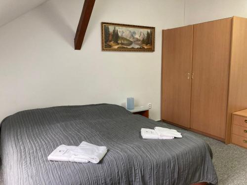 Postel nebo postele na pokoji v ubytování Penzion Grasel