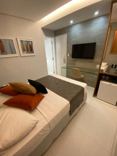 A bed or beds in a room at Bianca Praia Hotel