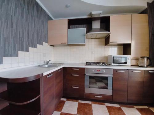 A kitchen or kitchenette at Apartment Mazurova