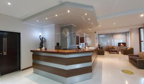 The lobby or reception area at Omiros Hotel