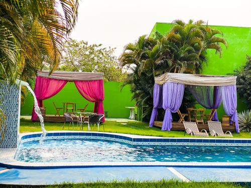 The swimming pool at or near Hotel Caranda Eco Ville