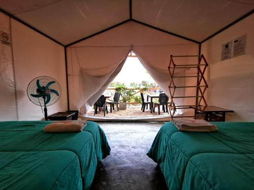 A bed or beds in a room at Desert Nights Ecocamp