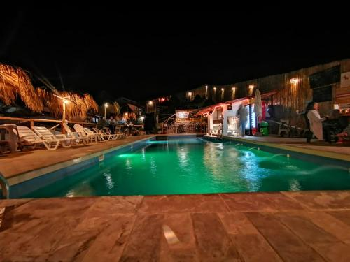 The swimming pool at or near Desert Nights Ecocamp