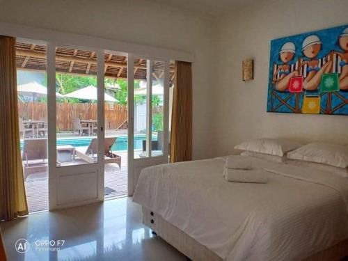 Cama o camas de una habitación en Soul Villas