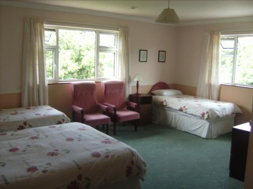 A bed or beds in a room at Westfield House