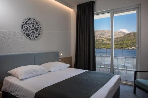 Een bed of bedden in een kamer bij Hotel Osmine - All Inclusive