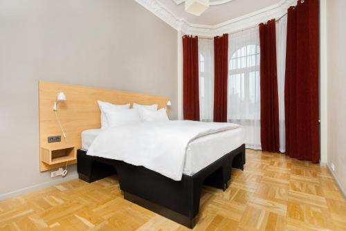 Кровать или кровати в номере Hotel Valdemars Riga managed by Accor