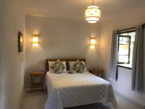 Cama ou camas em um quarto em Pousada Samambaia