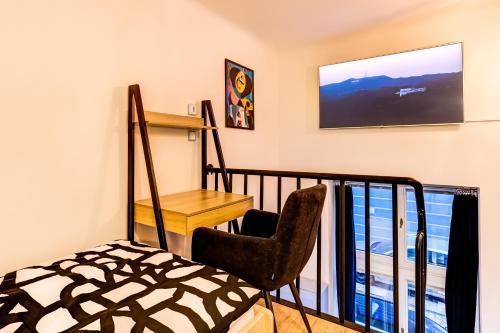 TV a/nebo společenská místnost v ubytování Mini apartmán Miró