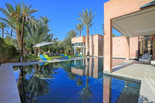 The swimming pool at or near luxury modern villa a la palmeraie