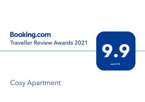 Um certificado, prêmio, placa ou outro documento exibido em Cosy Apartment
