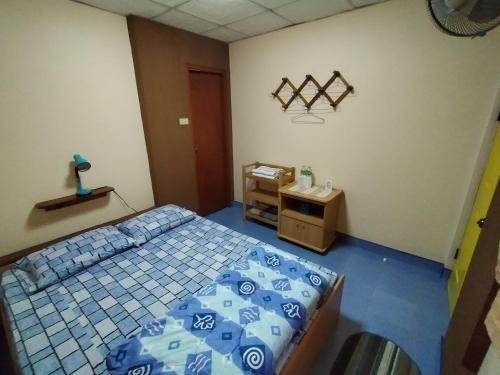 A bed or beds in a room at Khoom Kam Kaew