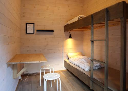 A bunk bed or bunk beds in a room at Trolltunga Camping