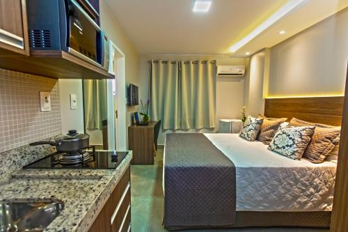 A kitchen or kitchenette at Hotel Flat Concept